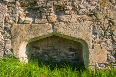 A Tudor fireplace in the south range wall