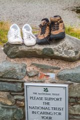 Grange in Borrowdale, Walking boots left behind to on a stone gatepost