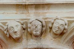Carved heads, nave capital