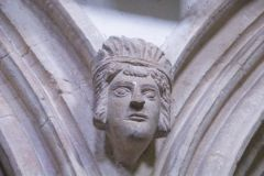 Carved head between nave arches