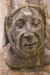 Carved head on the church exterior