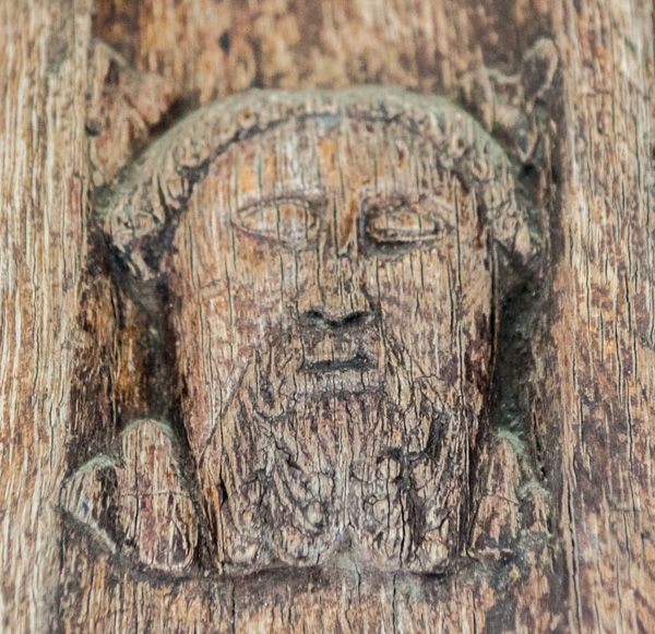 Higham, St Mary's Church photo, Carved face on the south door