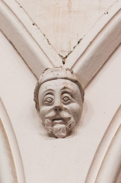 Honiton, St Paul's Church photo, A humorous carved head in the nave arcade