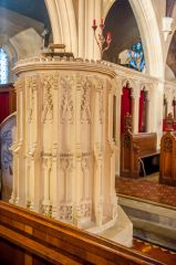 The cylindrical stone Victorian pulpit