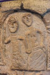 Depiction of St Bertram and his wife on the font