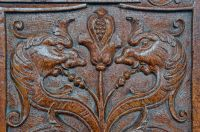 Carved bench end in church