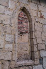 A blocked lancet window in the north chapel wall