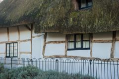 Thatched, timber frame cottage opposite the church