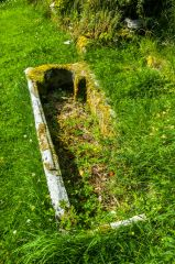 A stone coffin set into the ground