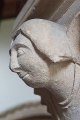 Carved head, nave pillar