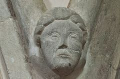 13th century carved head in the nave