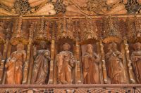 Carved figures on the screen