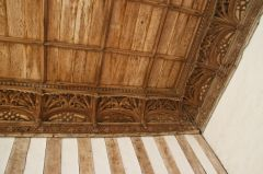 The ornately carved 15th century wooden cornice
