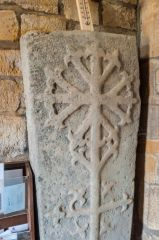 Lyddington, St Andrew Church, Floriated cross grave slab in the church porch