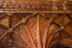 The intricately carved screen cornice