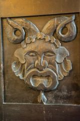 A grotesque carving of a horned figure