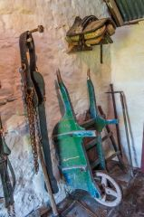 Wheelbarrow and tools in the shed