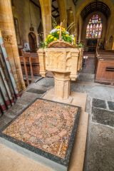 The 15th century font and 13th century tiles