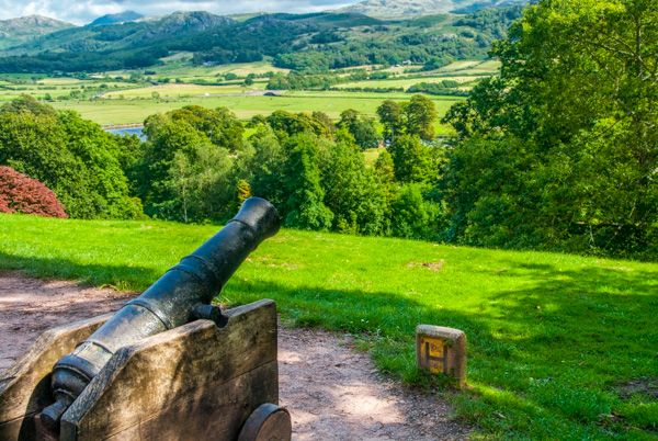 Muncaster Castle photo, A cannon looks out from the castle entrance