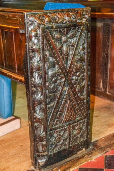 Northleigh, St Giles Church photo, 15th century bench end, St Andrew's cross