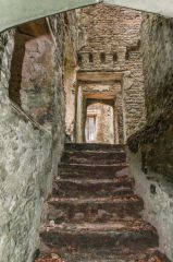 A very worn staircase to from the cellars