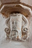 Corbel head carving