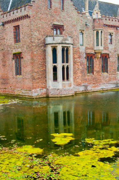 Oxburgh Hall photo, The moat and Elizabethan window