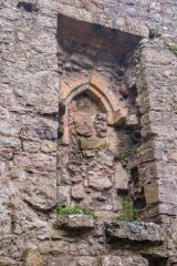 Penmon Priory, Niche in the priory wall