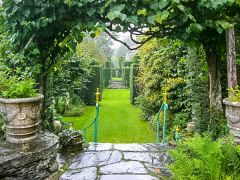 Plas Brondanw Gardens, A garden path in the rain (c) Robert Rimell