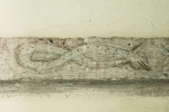 String course carving of a serpent