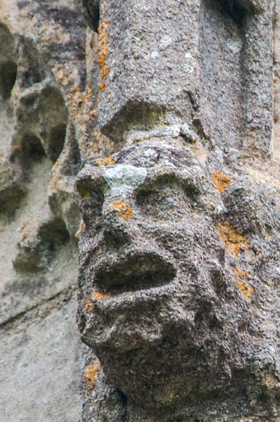 Ramsey Abbey Gatehouse photo, Carved head on the blind arcading