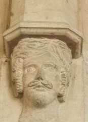 Carved head on the chancel arch