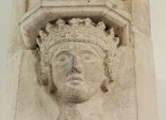 Carved head of a queen on the chancel arch