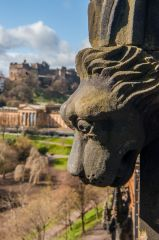 Carved dog head with Edinburgh Castle beyond