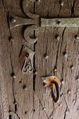 The medieval oak door and iron fittings