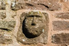 Carved head over the south porch entrance