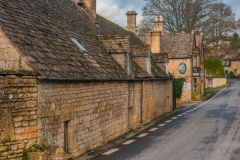 Cotswold stone cottages near the church