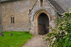 Approaching the south porch of St Peter's, Southrop