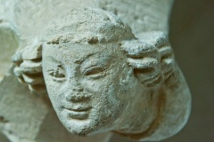Carved head, chancel