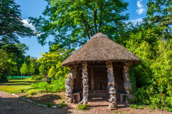 Spetchley Gardens photo, A thatched Root House in the Cork Lawn