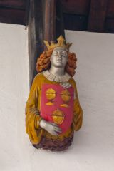 A painted corbel head