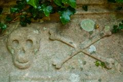 St Columba's Chapel, Holy Well, & Footprints, Skull and crossed bones on a gravestone