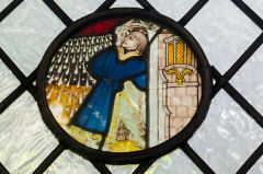 Medieval stained glass roundel, south aisle