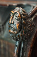 Carved medieval bench end in the chancel