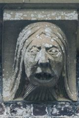 Grotesque carving on the exterior wall