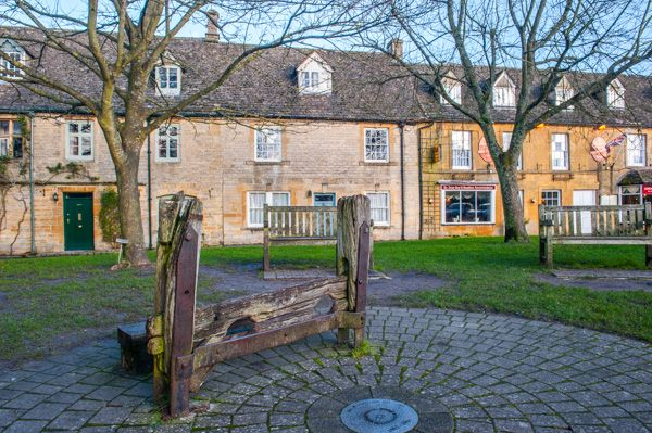 Stow on the Wold photo, A set of old stocks on the green