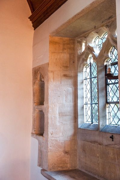 Stowell, St Leonard's Church photo, Chancel, 12th century piscina and 13th century credence shelf