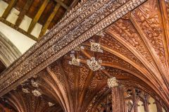The ornately carved screen canopy