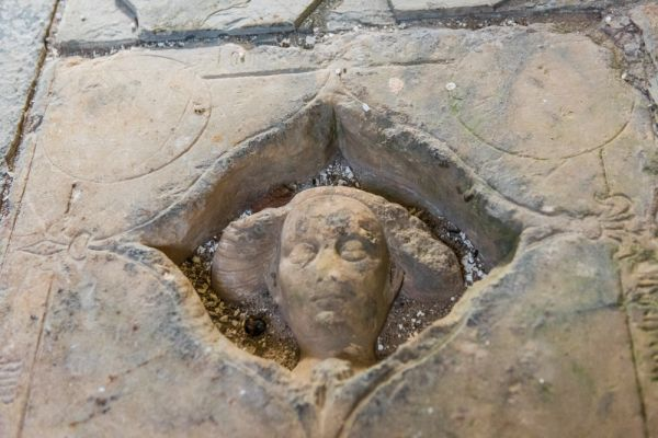 Talbot Chapel photo, Medieval grave slab with a woman's head