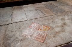 Medieval floor tiles by the altar